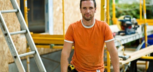 Contractor in orange shirt on remodel job site