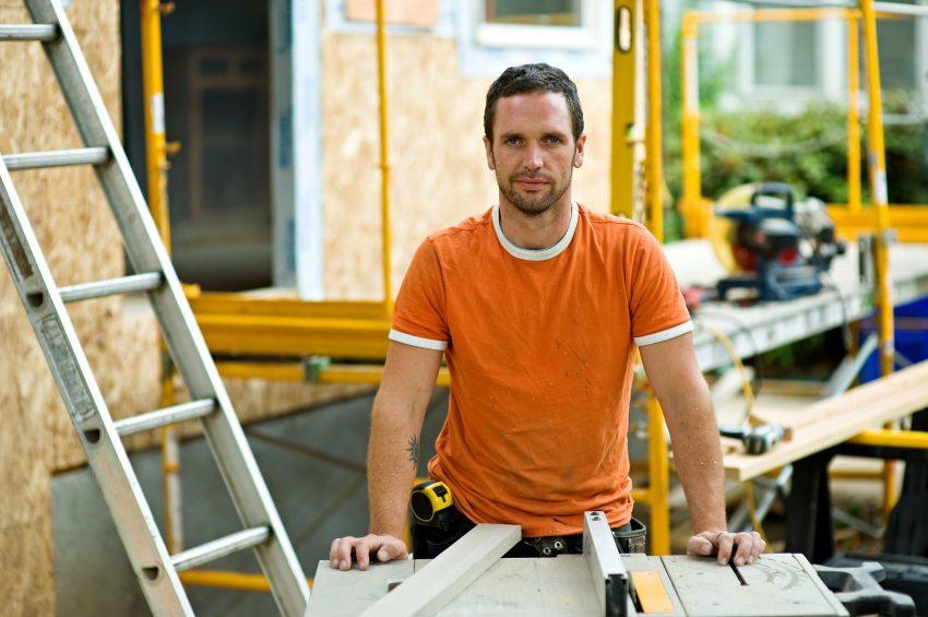 Contractor in orange shirt on remodel job site