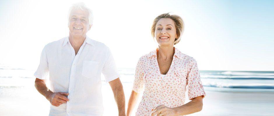 senior-couple-happy-on-beach