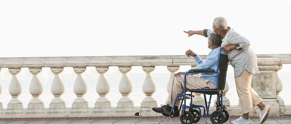 wheelchair-couple-on-boardwalk