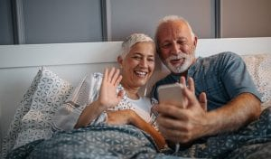 senior couple on video call with family