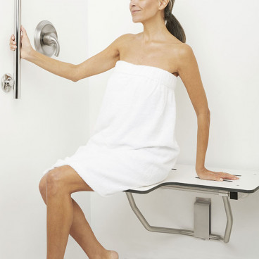woman seated on shower bench in the shower