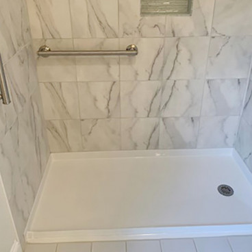 freedom curb free shower pan with tiled walls