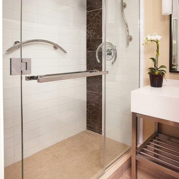 crescent grab bar in the shower