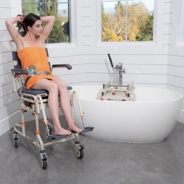 girl in TubBuddy seat beside oval tub