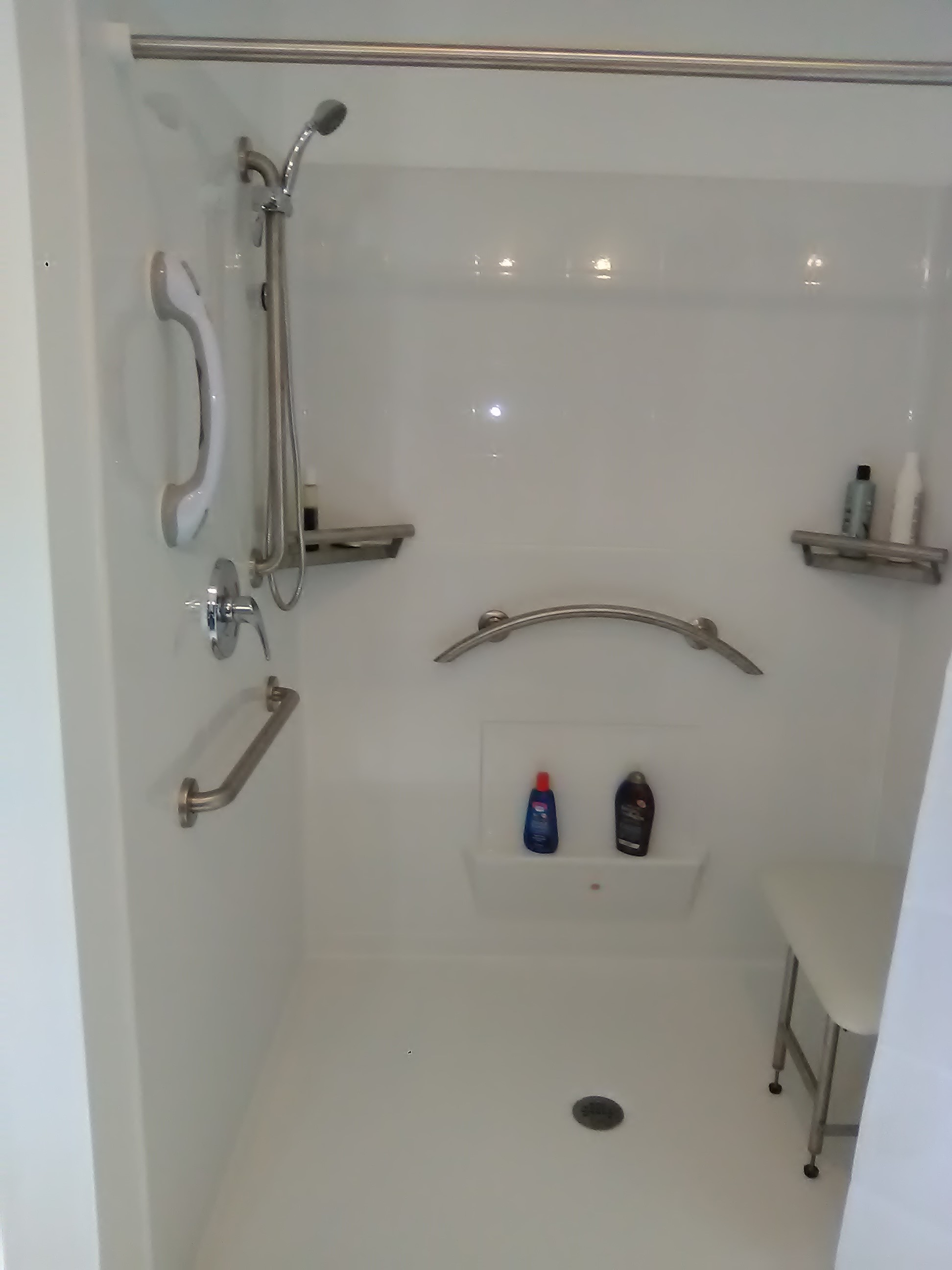 new Freedom Accessible Shower with crescent grab bar and accessories.