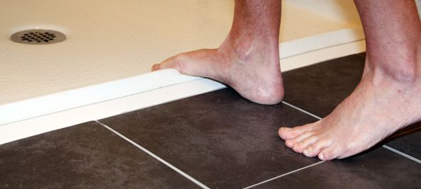 bare feet stepping on collapsible water retainer