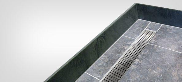 Trench drain tiling shower bases with linear drain