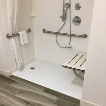 accessible shower pan for a hotel