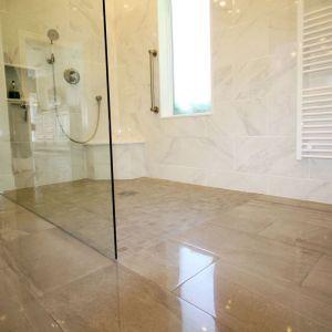 level entry tile over shower pan