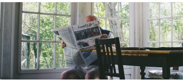 senior man reading news paper